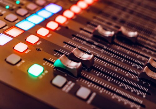 mixing-console-recording-with-faders-bright-buttons_116317-499